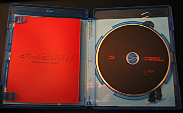Picture of the inside of the BD case with the booklet and the disk
