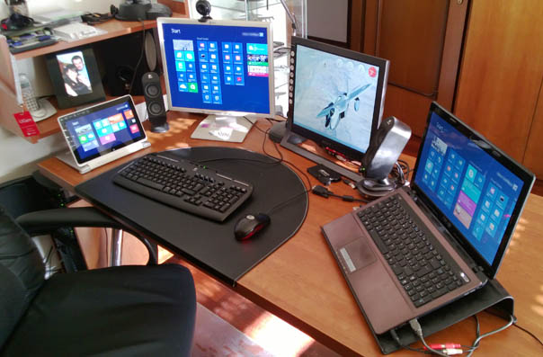 My desk with two PCs and the Iconia W510