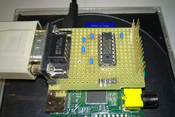 Serial Port Circuit mounted over a Raspberry Pi B rel. 2